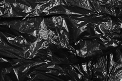 Black plastic bag texture and background