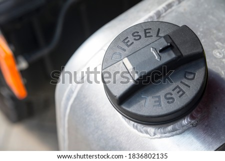 Black plastic cap of aluminum gas tank in silver color with the inscription 'DIESEL'. The fuel tank of the truck is closed with a cap. The concept of rising fuel prices in the world. Stock photo ©