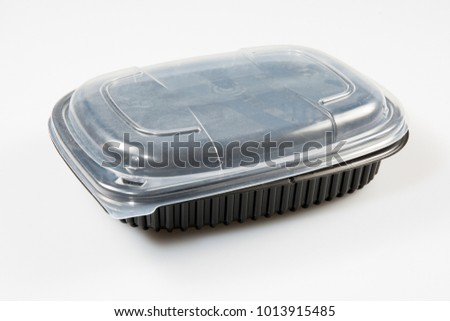 Black plastic container for dairy foods. Isolated on a white #1013915485