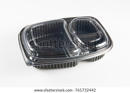 Black plastic dish with a lid and two compartments to put meat food and its vegetables #765732442