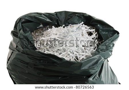 Black plastic garbage bag filled with shredded paper isolated on white background