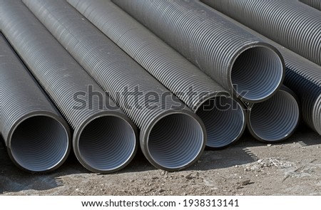 black plastic pipes for water supply or sewerage prepared for installation or repair of the water supply system Stock photo ©