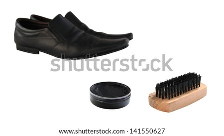 Black polish and wooden shoe brush to clean black leather shoes isolated on white