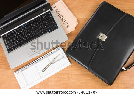 Black portfolio and the computer - stock photo