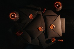 black postage envelopes with wax seal