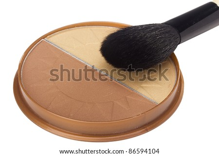Black powder brush and brown powder isolated on a white background.