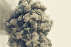 Black powder explosion.Colored cloud.Black dust explode.Paint Holi.Bomb smoke background,Smoke caused by explosions