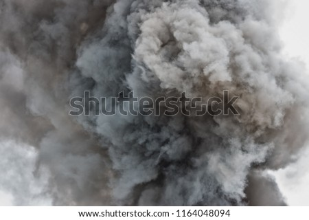 Photo of  Black powder explosion.Colored cloud.Black dust explode.Paint Holi.Bomb smoke background,Smoke caused by explosions