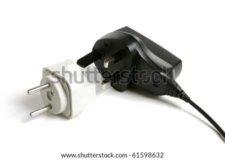 Black power plug UK type with European adapter on a white background