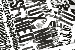 Black print on a white background. Creative typography. Newspaper and wallpaper. Design and creative typography.
