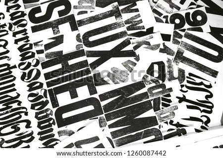 Black print on a white background. Creative typography. Newspaper and wallpaper. Design and creative typography.                     #1260087442