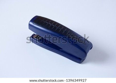 Black professional stapler isolated on white background