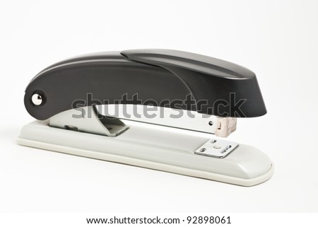 Black professional stapler isolated on white background