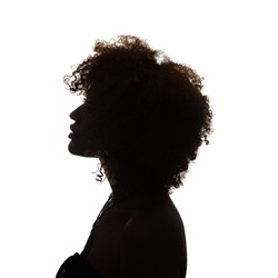 Black profile of an African woman on a white background, shaded silhouette, head and shoulders.
