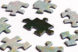 Black puzzle piece surrounded by white pieces. Oppression concept.