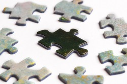 Black puzzle piece surrounded by white pieces  Oppression concept