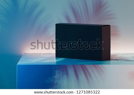 Black realistic cardboard box on multicoloured background. 3d rendering.
