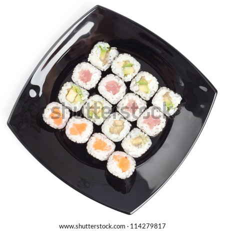 Black rectangle plate with sushi, isolated on white. Top view