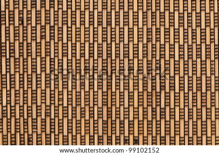 black rectangular patterns on wooden background