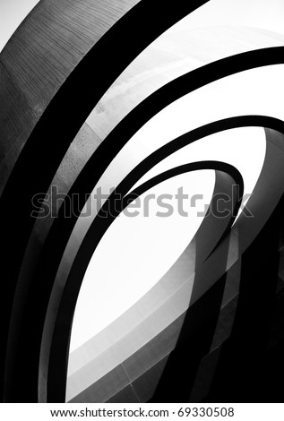 Black repeating architectural details in the form of arches - stock photo