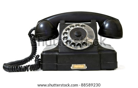 black retro phone on a white background