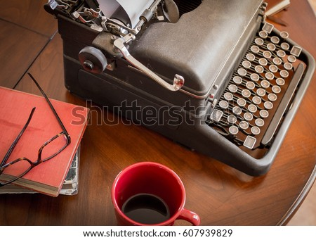 black retro typewriter sitting...