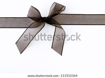 Black ribbon against white background