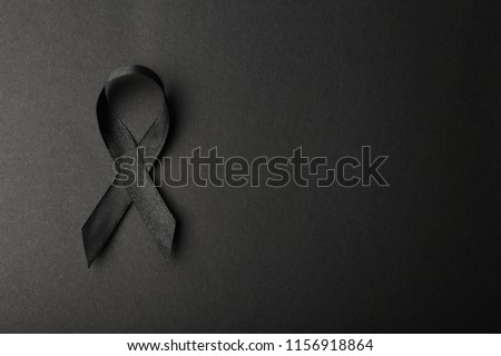 Black ribbon and space for text on dark background, top view. Funeral accessory Сток-фото ©