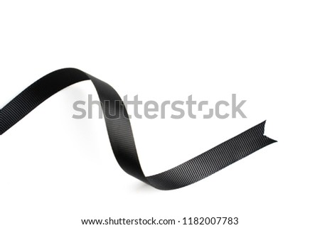 Black ribbon in roll on white background