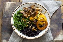Black rice with roasted delicata squash, massaged kale and shiitake mushrooms
