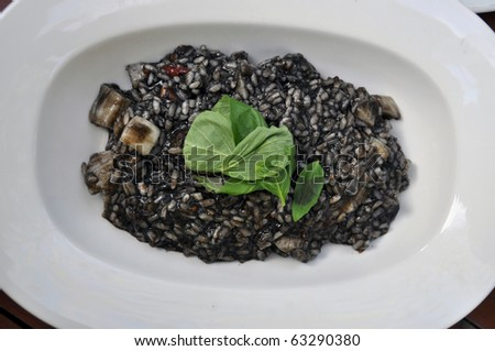 Black Risotto. The color comes from the ink of squids (calamarys) - stock photo