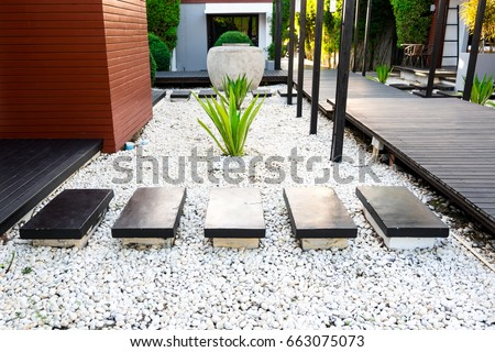 Black Rocks Walking Way In Tropical Garden, Black Stones Garden Path On  White Pebbles And