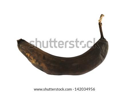 Black rotten banana isolated over white background