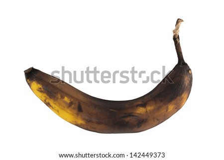 Black rotten banana isolated over white background