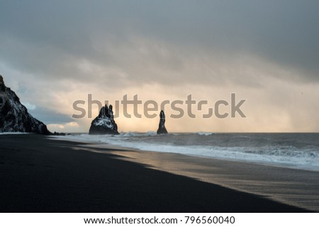 black sand beach of Reynisfjara and the mount Reynisfjall from the Dyrholaey promontory in the southern coast of Iceland, Vik #796560040