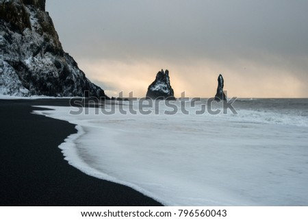 black sand beach of Reynisfjara and the mount Reynisfjall from the Dyrholaey promontory in the southern coast of Iceland, Vik #796560043