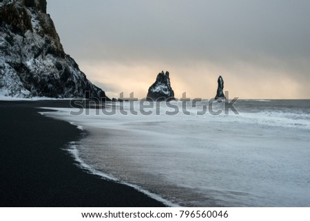 black sand beach of Reynisfjara and the mount Reynisfjall from the Dyrholaey promontory in the southern coast of Iceland, Vik #796560046