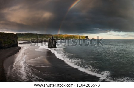 Black Sand Beach Reynisfjara in Iceland. Windy Morning. Ocean Waves. Colorful Sky. Morning Sunset.