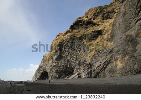 Stock Photo Black sand Reynisfjara Beach in Iceland. Rocks and cliffs at ocean beach. A popular tourist spot on the south coast of Iceland.