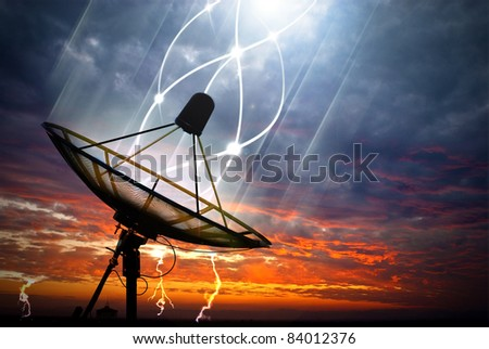 Black satellite under storm clouds