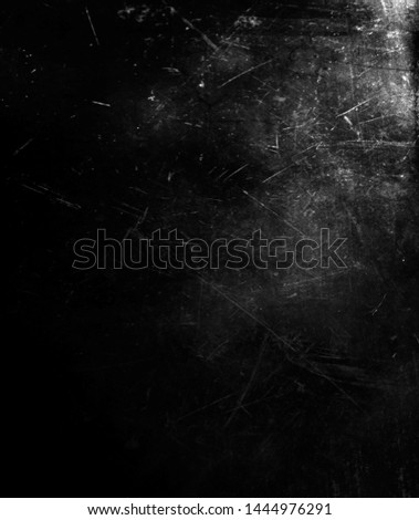 Black scratched grunge background, distressed scary horror texture perfect for halloween concept #1444976291