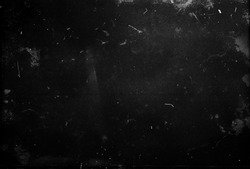 Black scratched grunge background, dusty scary horror texture, old film effect, space for your design