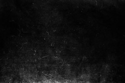 Black scratched grunge background, old film effect, dusty scary texture