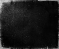 Black scratched grunge movie background, old film effect, scary distressed texture with frame