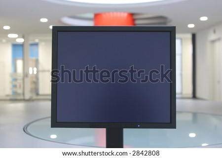 Black screen in the reception hall of big building