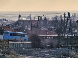 Black sea, morning, the industry and the blue bus
