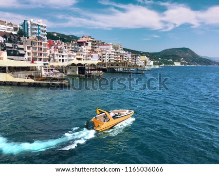 Black Sea, the marine landscape. Seascape on a sunny day - the bay, cliffs and yacht. Beautiful seascape - yacht in a quiet bay #1165036066