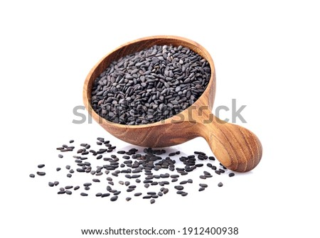Black Sesame seeds in wooden spoon isolated on white background Foto stock ©
