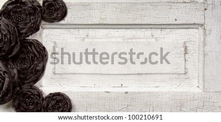 Black shabby chic flowers on vintage door