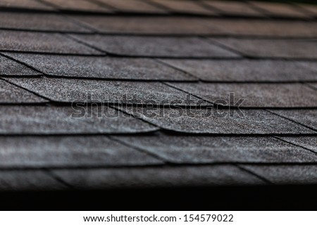 Black Shingles On A Roof In Close Up
